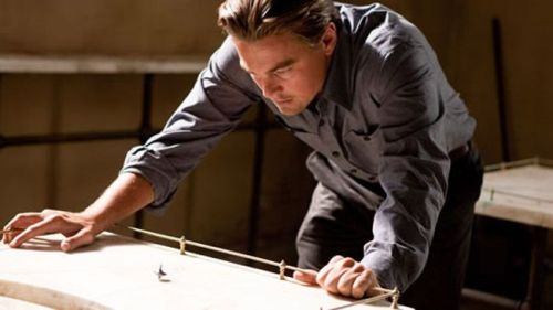 "the-decoy:     50 Mind-blowing Fan Theories: Inception (2010)  The Fan Theory: Cobb's totem isn't actually his spinning top, but his wedding ring. In the ""real world"" he takes it off, but in the dream world, he's always wearing it…Why It's Mind-Blowing: Because if you subscribe to this theory, it clears up the ending once and for all, as you get a brief glimpse of Cobb's hand and… no ring.      While this theory and many others are very interesting and could very well be true, there are a few that just have their facts wrong.  Such as the theory that the aliens in Signs are demons because the water in the end that harms them is from a priests house, therefor it's holy water… The water wasn't from a priests house. The water was from their house and it had something to do with the little boy, he left glasses of water everywhere."