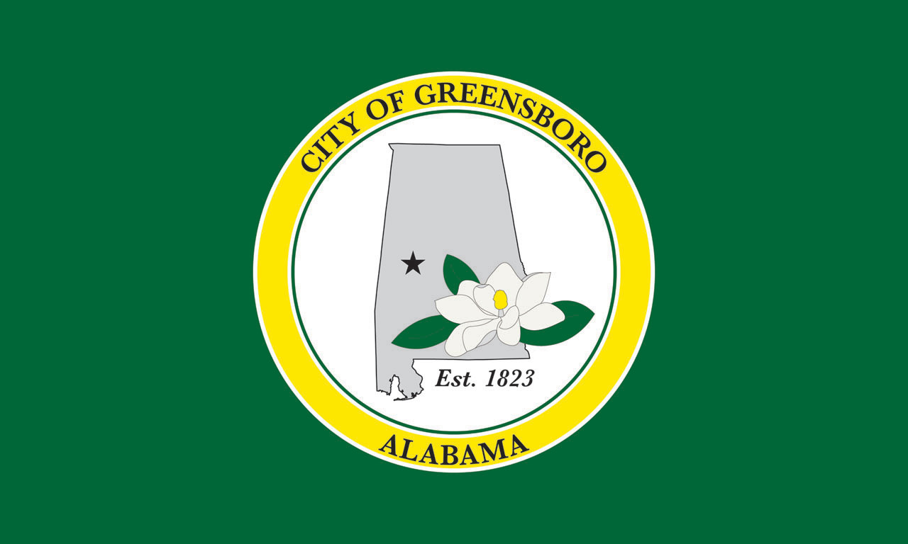 the City of Greensboro gets a new flag Last week, Rural Studio staff members Cameron Acheson and Mackenzie Stagg presented proposals for a flag for the City of Greensboro at the council meeting. A couple of weeks prior, the city had held a workshop to brainstorm ideas for a city flag. After they made a mock-up of their ideas, the council asked Rural Studio to help iron out the design. A number of variations were presented at the council meeting, and the winning design can be seen above.