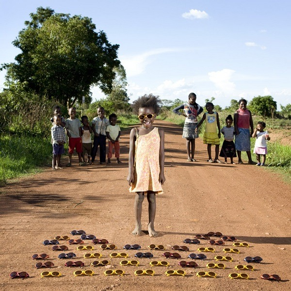 "Maudy - Kalulushi, Zambia Children and their favorite toys by Gabriele Galimberti ""The richest children were more possessive. At the beginning, they wouldn't want me to touch their toys, and I would need more time before they would let me play with them…In poor countries, it was much easier…even if they only had two or three toys, they didn't really care. In Africa, the kids would mostly play with their friends outside."""