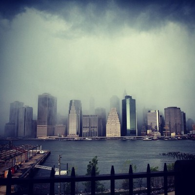 skinnywashere:  Vanishing Act- storm engulfed the city #storm #nyc #rain #city #newyorkcity #canon #transcend #skinnywashere #clouds #manhattanbridge #brooklyn (at Manhattan Bridge North Plaque)