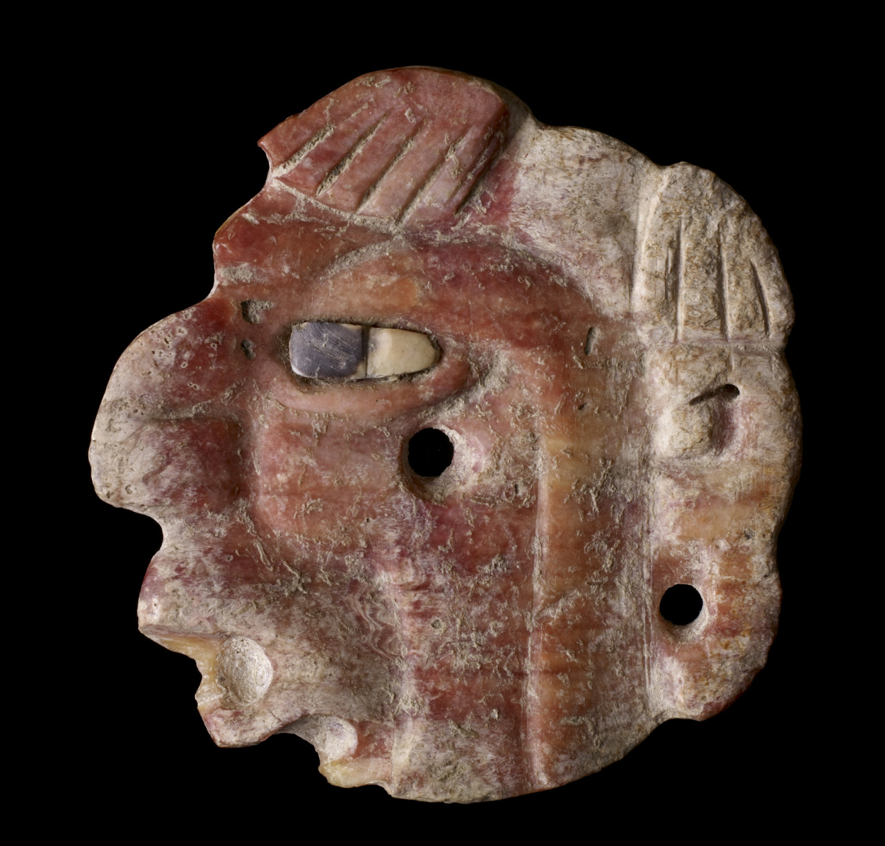 Mayan Engraved Profile Head with Inlaid Eye, AD 600-900 (Late Classic), made of shell with inlay. Courtesy & currently located at the Walters Art Museum, USA.