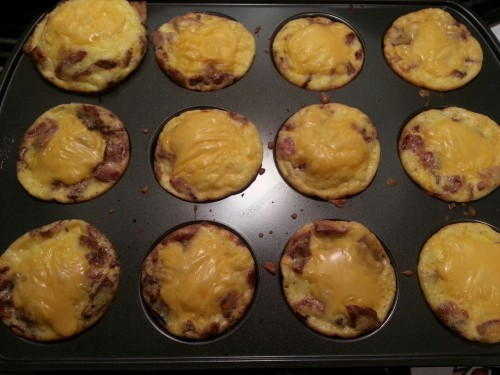 Bacon, egg, and cheese muffin top things They weren't perfect but basically you cook and crumble a ton of bacon, beat some eggs with heavy cream and shredded cheese, salt, pepper, garlic and onion powder to taste. Pour over bacon in muffin top tin and cook @350 for like 10-15 mins, add 1/4 a slice of cheese on top, bake until it melts, then eat <3 I cooked them too long so they were a bit chewy but still decent :P