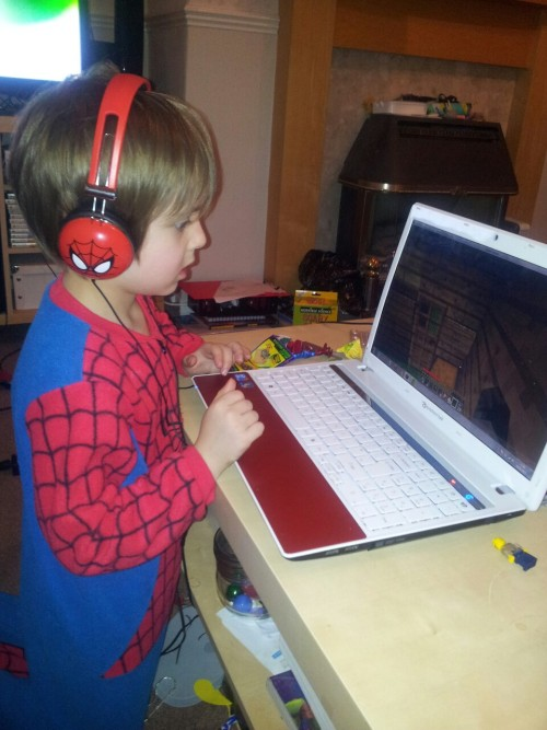 My little man playing Minecraft