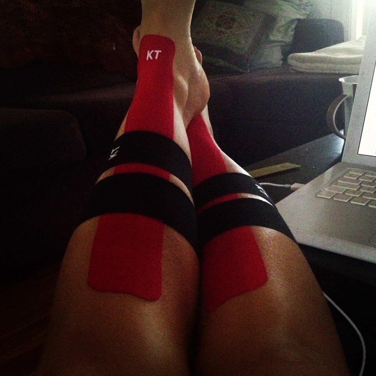 Kt taping my shins! Whoops did a bit to much running