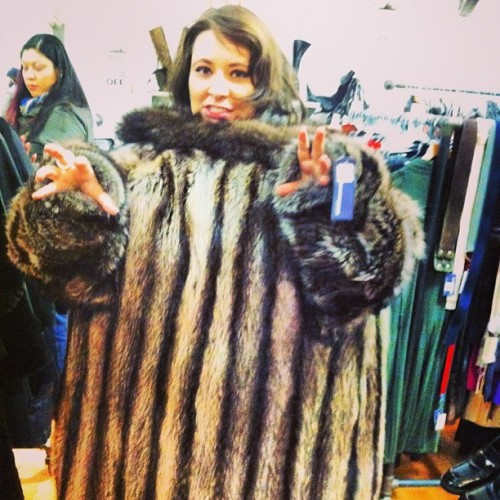 rawr! trying on the biggest fur coat ever (at Housing Works Thrift Shop)