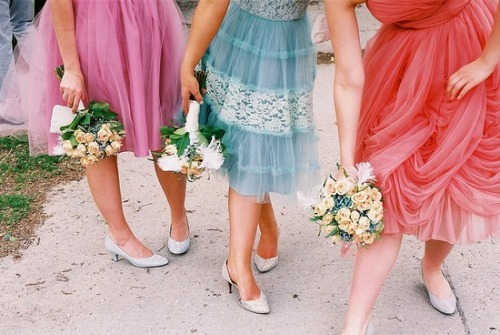 Fun vintage bridesmaids dresses  photo by meg kroeker