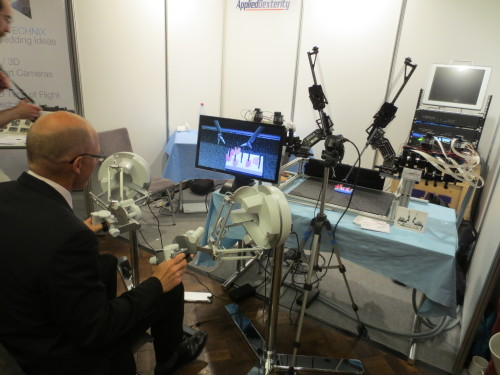 The Applied Dexterity booth at ICRA 2013 Karlsruhe was a tremendous success!  The highlight of the show was a spontaneous collaboration with Force Dimension connecting the Sigma.7 haptic interface to the Raven II surgical system. It was decided on Tuesday that we should try the Sigma.7 as a master,.  Tuesday night we wrote the necessary code while sitting outside at the AlteBank Biergarten, and debugged with a little help from the Force Dimension engineers.  Wednesday was a complete success and a great demonstration of both devices capabilities, and the power of open-source software!  Pictured: Patrice Rouiller, Force Dimension CTO http://www.forcedimension.com/