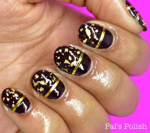 polishpallavi:  Used both the gold leaf topcoat and striping tape my sister got for me for this  manicure! The base color is Pat on the Black from Sally Hansen. I feel so fancy with these nails :) I seriously have the best older sister ever!