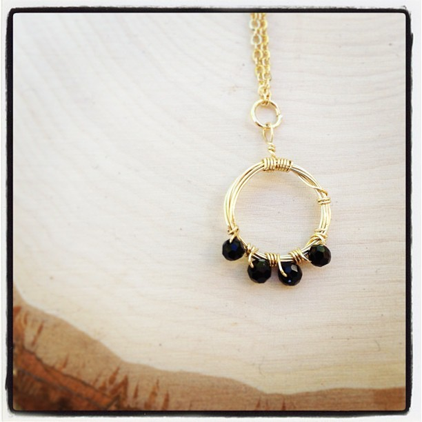 Ring of #black glass delicacies. Hangs on a long #gold chain. #jewelry #jewelrydesign #handmade #artists #necklace #fashion #instafashion #chic #cute #crafty #design #etsy #shopping