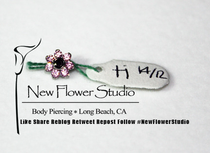 here's one of our new little flower gem ends.  We put these on navel and conch barbells.
