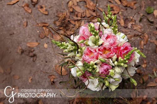 Tulips, snapdragons, and lisianthus, oh my!  Pretty pink and white bridal bouquet. Image by Caroline Johnson Photography