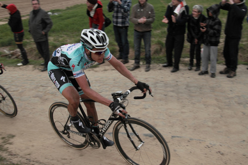Niki Terpstra | Paris-Roubaix 2012 on Flickr.Via Flickr: Paris–Roubaix is a one-day professional bicycle road race in northern France near the Belgian frontier. From its beginning in 1896 until 1967 it started in Paris and ended in Roubaix (hence the name); since 1968 the start city has been Compiègne (about 60 kilometres (37 mi) north-east from Paris center) whilst the finish is still in Roubaix. Famous for rough terrain and cobblestones (setts),[n 1] it is one of the 'Monuments' or Classics of the European calendar, and contributes points towards the UCI World Ranking. It has been called the Hell of the North, a Sunday in Hell (also the title of a film about the 1976 edition of the race), the Queen of the Classics or la Pascale: the Easter race.[1] The race is organised by the media group Amaury Sport Organisation annually in mid-April. First run in 1896, Paris–Roubaix is one of cycling's oldest races. It is well known for the many 'cobbled sectors' over which it runs, being considered, along with the Ronde van Vlaanderen and Gent–Wevelgem to be one of the cobbled classics. Since 1977, the winner of Paris–Roubaix has received a sett (cobble stone) as part of his prize.[2] In recent years, the terrain over which Paris–Roubaix runs has led to specialized bikes, with unique frames and wheels, being used. Wheel punctures and other mechanical problems are extremely common because of this terrain, and often play a part in who is able to ultimately make it to Roubaix with momentum. Despite the high esteem with which the race is seen, some notable cyclists throughout history have regarded the race as a joke because of its difficult conditions. The race has also seen several controversies over the years, with many seeming winners of the race disqualified for various reasons. The course is maintained by Les Amis de Paris–Roubaix, a group of fans of the race formed in 1983. The forçats du pavé seek to keep the course as safe as possible for riders while maintaining its difficulty.