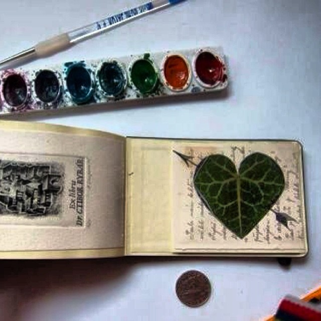 I SO LOVE Eastern Europe flea markets! This is something I made with stuff I bought and a leaf cut. - from my Prague sketch book! Oh how I wish I could make a living doing this! #moleskine #thesketchingbackpacker #watercolor #sketchbook #sketch #drawing #illustration #travel #sketchpad #art #slowtravel #backpacking #sketchbookproject #sketchaday #sketchoftheday #sketching #ink #pen #robertalejandro #praque #heart #leafart