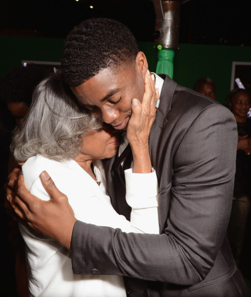 "Mrs. Rachel Robinson and actor Chadwick Boseman who portrays her late husband, Jackie Robinson embrace at the Hollywood premiere of the film ""42"""