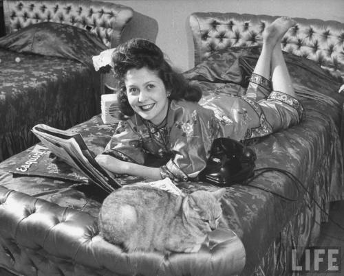 """Ettie relaxing on her bed reading Esquire, with her cat and phone close by.""  Photograph by George Silk, Shanghai, China, 1946. Source: LIFE Photo Archive, hosted by Google."