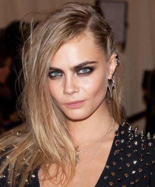 Cara Delevingne Punk Style Spike Earrings,  Smokey eyes, Neutral Lips & Side Hair. at the Red Carpet of Costume Institute Gala for the 'PUNK: Chaos to Couture' exhibition at the Metropolitan Museum of Art 2013. May 7th, 2013 7:53 P.M. GMT.