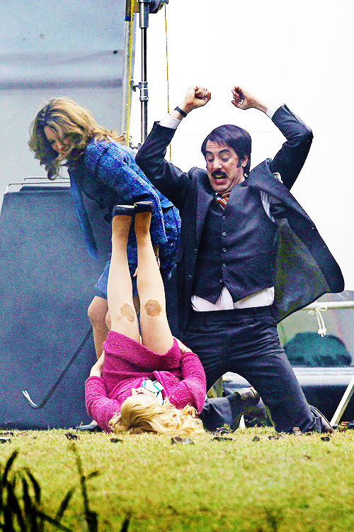 Tina Fey, Amy Poehler and Sacha Baron Cohen filming scenes for Anchorman 2