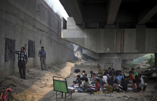 "Indian hero called Rajesh Kumar Sharma .. This guy began educating New Delhi's poorest children "" and even went as far as creating a free school for them under a metro bridge. For two hours every weekday, Sharma leaves his day-job at a general store in Shakarpur — his brother fills in for him — so that he can teach the children ."