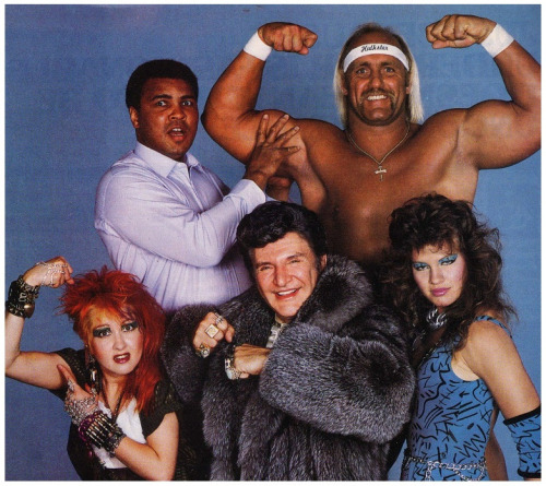 "hodgman:  browsethestacks:  Muhammad Ali, Hulk Hogan, Cyndi Lauper, Liberace And Wendi Richter  Your first look at @JossActual 's new prequel series ""Avengers: 1984"""