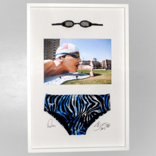 "Framed ""Omaha Swimmer vs. Scott Blake"" with the actual Speedo and goggles used in the public performance. Signed by the photographer Daniel Muller and Scott Blake. Limited edition of 1 for $3,000 BarcodeArt.com/artwork/videos/omaha/framed_speedo.html"