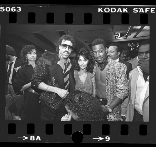 "wow.  Just wow. slatevault:  Lionel Richie, Apollonia Kotero, and Eddie Murphy at premiere of motion picture ""Purple Rain,"" in Los Angeles, Calif., 1984.  UCLA Digital Collections."