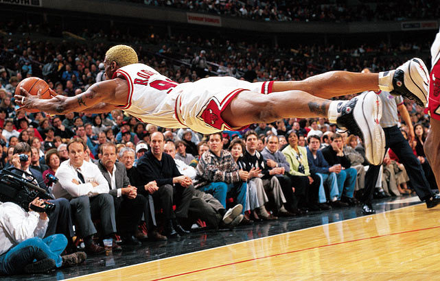Bulls forward Dennis Rodman goes horizontal for a loose ball during a 1997 game against the Pacers at the United Center in Chicago, Ill. (Sam Foreninch/Getty Images) GALLERY: The 100 All-Time Greatest Sports Photos