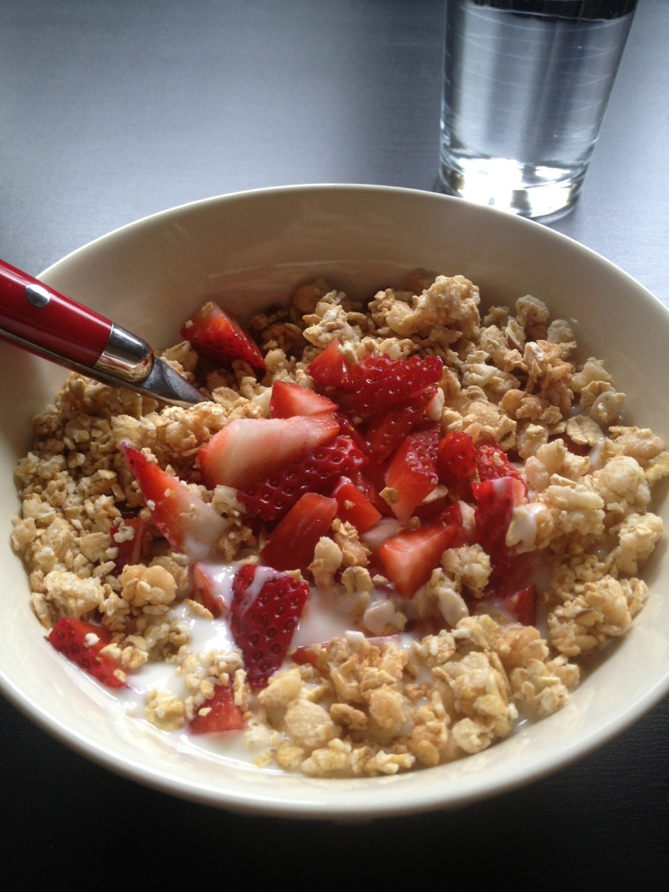 One of my favorite breakfasts! Vanilla yogurt, no sugar granola and fresh strawberries. So yum!
