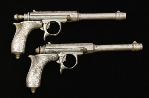 Pair of nickel plated single shot needle fire pistols made by  L. Joalland & Cie Bte. S. G. O. G., 19th century.