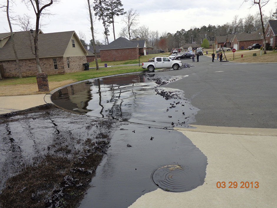 "#Arkansas #OilSpill #WTF - Warren Andrews had just finished putting up balloons for his stepdaughter's 18th birthday party at their suburban home in Mayflower, Arkansas, when his wife came inside and said something was wrong.After stepping out of his house, and taking one glance, he immediately dialed 911. ""I don't know what's going on, but I've got a river of oil coming down the street at me,"" Andrews told the operator. Five minutes later, the slick of noxious black crude spewing from a ruptured Exxon Mobil pipeline was eight feet wide, six inches deep and growing fast. In this photo, spilled oil from Exxon pipeline runs through a neighborhood in Mayflower, Arkansas on March 29, 2013. Reuters was recently given access to the photo from the U.S. Environmental Protection Agency (EPA).   Exxon is refusing to let reporters anywhere near the accident. They're also controlling the airspace above the spill. They don't want you to see what's happening. TOO BAD, EXXON.  Is this really worth it?? Is it really worth the effort of pillaging our Mother's resources only to waste them and contaminate everything else in the process? No. Let this be a lesson for our children and the generations to come.. this cannot go on for much longer."