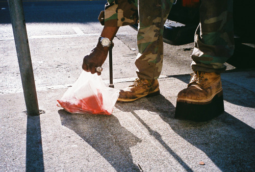 Bloody beef bones and couture boots on Mission street.   The fellow who allowed me to make this photo is named Charles and he's a sweetheart.