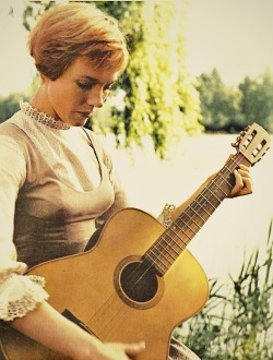 Julie Andrews looking deeply concentrated on the set of The Sound of Music (1965).