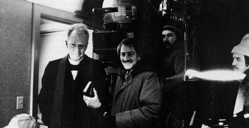 Max Von Sydow and cinematographer Owen Roizman share a lighter moment while working within the refrigerated bedroom on the set of The Exorcist. Heavy coats were required for the crew as the temperature hovered below zero in order to make the actors' breath show up under the glare of the hot lights.