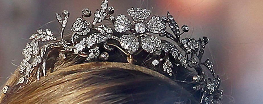 THE FLORAL TIARA This tiara is made of diamonds set in gold and silver in floral and vegetable motifs, and is the personal propriety of Her Majesty. It was a wedding gift from the Spanish people to Princess Sophia of Greece and Denmark on the occasion of her wedding to Prince Juan Carlos of Spain. Despite being one of their favorite diadems not much was known of its origins besides the fact that it was acquired in Madrid's Aldao Jewellery Firm in 1962.  After the Princess of Asturias wore it to Queen Beatrix's dinner on April 29, 2013 the Royal Household explained that this tiara had already belonged to the Royal Family long before 1962. King Alfonso XII commissioned this tiara to the British jewellers J.P. Collins in 1879 as a gift for his betrothed Archduchess Maria Christina of Austria-Teschen. Since then the piece left the family and in the 20th century ended in Aldao, where Franco would buy it as a wedding gift. The central flower is adapted to be used as a brooch. It is believed that Princess Sophia used this gift for the first time at her pre-wedding ball as a necklace although the quality of the pictures is not good:    Doña Sofía would not wear the gift in a tiara frame until 1979 during a Sate Visit to Sweden. It has become one of her favorite diadems since then.   The Queen has frequently shared the tiara with her daughters and daughter-in-law, the Infanta Cristina chose it for her wedding. Her sister Doña Elena, however, only used it before her wedding in 1995, when she received a tiara from the groom's family:     The floral tiara is one of the favorites of the Princess of Asturias: