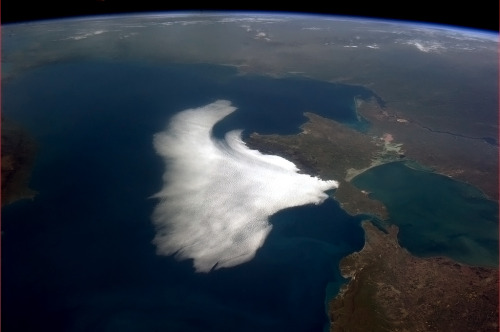 Clouds swoop in on Crimea, a white bird on the Black Sea.