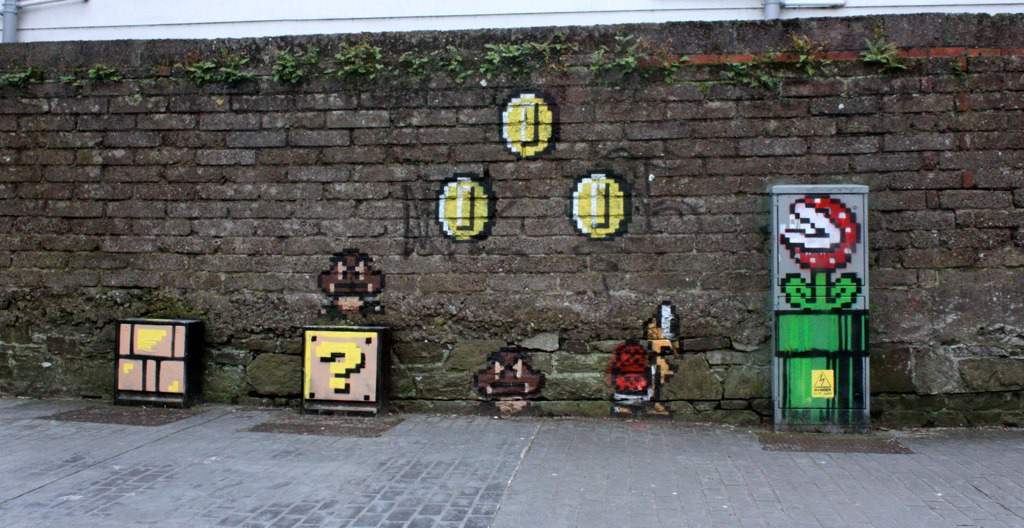 Daily Graffiti This crazy Super Mario Bros. 8-bit street art was added to our Geek Graffiti Flickr pool by Starman Super. It transforms electrical boxes into question mark blocks and other familiar objects from Mushroom Kingdom. Neat! Check it: The Daily Graffiti Archives Follow Albotas on Twitter | Like Albotas on Facebook