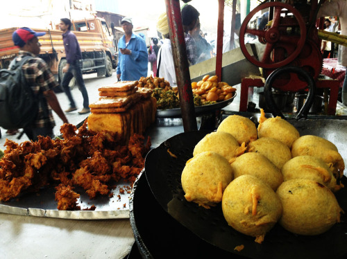 The first thing I ate in Mumbai was a vada pav, and it shall be the last thing I eat until I return! Packed with flavor, puffy and slightly crispy on the outside… Doused with chutneys and stuffed into a soft bun. Oh, vada pav, my favorite Indian street food. You will be missed…  I've negotiated a stop at the Juhu Beach chaat stands before heading to the airport tomorrow night!  Photo near Crawford Market, Mumbai