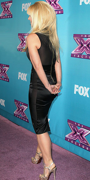 Better From The Back? Britney Spears Check out Britney's knee-length sheath from all sides here.