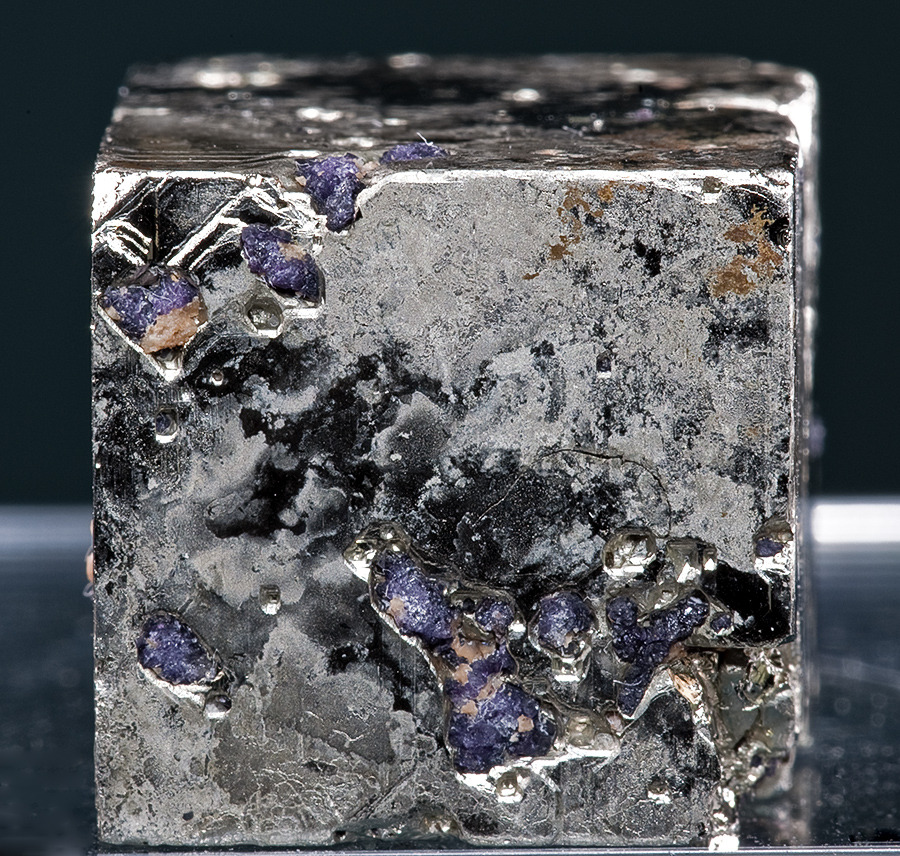 themineralogist:  A shiny Pyrite cube with inclusions of purple Fluorite