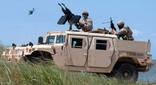 Here Come The Laser Jeeps: Navy Working on Vehicle-Mounted Lasers For Mobile Anti-Drone Warfighting  Today, the Office of Naval Research revealed its latest energy weapon craving: vehicle-mounted lasers that shoot down drones. Dubbed Ground-Based Air Defense Directed Energy On-The-Move, the project is offering private outfits up to $400,000 each to develop such a system that blasts at full power for 120 seconds and juices back up to 80 percent after a 20 minute charge. The beam is required to pack a punch of at least 25 kilowatts, while the ability to ratchet up to 50 kilowatts is optional. Given that kind of power, Wired points out that making such a solution fit in a Humvee is going to be a feat — especially when the Navy says it can't weigh more than 2,000 pounds and must fit entirely within a vehicle's cargo area.   (via US Navy to fund development of vehicle-mounted, drone-shooting lasers)