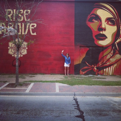Nell waving by a Shepard Fairey