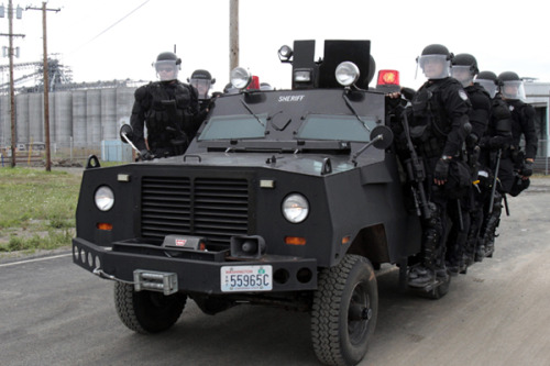 "thepeoplesrecord:  Police militarization comes under nationwide investigationMarch 6, 2013 The American Civil Liberties Union has launched a campaign to investigate the growing trend of placing militarized police units in cities and towns across the country. Doors busted down and windows smashed in. It's becoming more of a regular occurrence each day in America as heavily-armed SWAT teams are being sent to the homes of suspects, often nonviolent ones, with enough firepower to take down a small army. In November, a botched raid ended with an 18-year-old girl in the hospital. Other incidents haven't been exactly isolated either: guns get drawn on both grannies and grandkids alike, and equipping law enforcement officers with the means to make these nightmares become reality is easier by the day. Police units across the US are becoming more like militaries than the serve-and-protect do-gooders that every young schoolboy once aspired to be. Not only are officers being trained to act with intensity as the number of these home invasions increase, but more and more police departments are being awarded arsenals of heavy-duty weaponry that are then being turned not onto members of al-Qaeda, but innocent children and unsuspecting house guests. ACLU affiliates across the United States filed Freedom of Information Act requests with law enforcement agencies on Wednesday in hope of obtaining as much material as possible relevant to the ongoing expansion of small town police squads to heavily armed squadrons of soldiers. ""Federal funding in the billions of dollars has allowed state and local police departments to gain access to weapons and tactics created for overseas combat theaters – and yet very little is known about exactly how many police departments have military weapons and training, how militarized the police have become, and how extensively federal money is incentivizing this trend,"" reads a statement released by the ACLU.""It's time to understand the true scope of the militarization of policing in America and the impact it is having in our neighborhoods."" On Wednesday, the ACLU issued a statement saying branches and affiliates in 23 states around the country filed over 255 public records requests only hours after the investigation was formally launched. The agencies hope that, by analyzing documents, can learn more about the extent that ""federal funding and support has fueled the militarization of state and local police departments."" ""Equipping state and local law enforcement with military weapons and vehicles, military tactical training, and actual military assistance to conduct traditional law enforcement erodes civil liberties and encourages increasingly aggressive policing, particularly in poor neighborhoods and communities of color,"" explains Kara Dansky, senior counsel for the ACLU's Center for Justice. ""We've seen examples of this in several localities, but we don't know the dimensions of the problem."" The ACLU says they want to know as much as possible about the type of training given to local SWAT officers, as well as information about the types of technology used by agencies around the country. Through the FOIA requests, the ACLU hopes to learn what types of weapons have been used, who they've been used on and what the end result has been. They also want documentation pertaining to the growing use of GPS technology, surveillance drones and any agreements between local police departments and the National Guard. The ACLU is also interested in any relationships between small law enforcement units and the US Departs of Defense and Homeland Security. ""The American people deserve to know how much our local police are using military weapons and tactics for everyday policing,"" adds Allie Bohm, an advocacy and policy strategist for ACLU. ""The militarization of local police is a threat to Americans' right to live without fear of military-style intervention in their daily lives, and we need to make sure these resources and tactics are deployed only with rigorous oversight and strong legal protections."" In 2011, the Department of Defense gave half-a-billion dollars' worth of military machinery that would have been left otherwise unused to law enforcement agencies coast-to-coast. Among the items offered up to officers at no cost at all that year were grenade launchers, helicopters, military robots, M-16 assault rifles and armored vehicles. Before 2012 came to a close, figures for that year was expected to end with more than a 400 percent increase. Peter Kraska, a criminologist at Eastern Kentucky University, tells journalist Radley Balko that while the militarization of police squads is indeed accelerating, it isn't likely the ACLU will get all the answers they want. ""My experience is that they'll have a very difficult time getting comprehensive, forthright information,"" Kraska says. ""If the goal here is to impose some transparency, you have to understand, that's not what the SWAT industry wants."" Source"