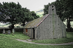 The tiny Church of St.Olaf.Wasdale Head, Cumbria. UK. Gravestones dedicated to mountaineers.