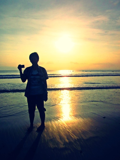 Raih photo with sunset in Kuta Beach, Bali, Indonesia