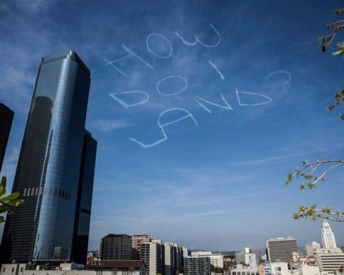 "thekhooll:  How Do I Land?  ""Skywriting is crazy. We're forcing clouds to say things. That's inherently funny. How great would it be to look up one day and there's a message in the sky, for no other reason other than itself. It's not trying to sell you anything, it's not trying to tell you something. It's just there."" Los Angeles-based comedian Kurt Braunohler crowdsourced funds on Kickstarter to ""hire a man in a plane to write stupid things with clouds in the sky."" On March 23rd, a professional skywriter wrote out the words ""How Do I Land?"" in the skies above Los Angeles."