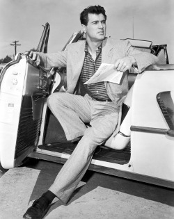 "thevanisher:  Rock Hudson in his custom convertible, made to accommodate his 6'5"" height."