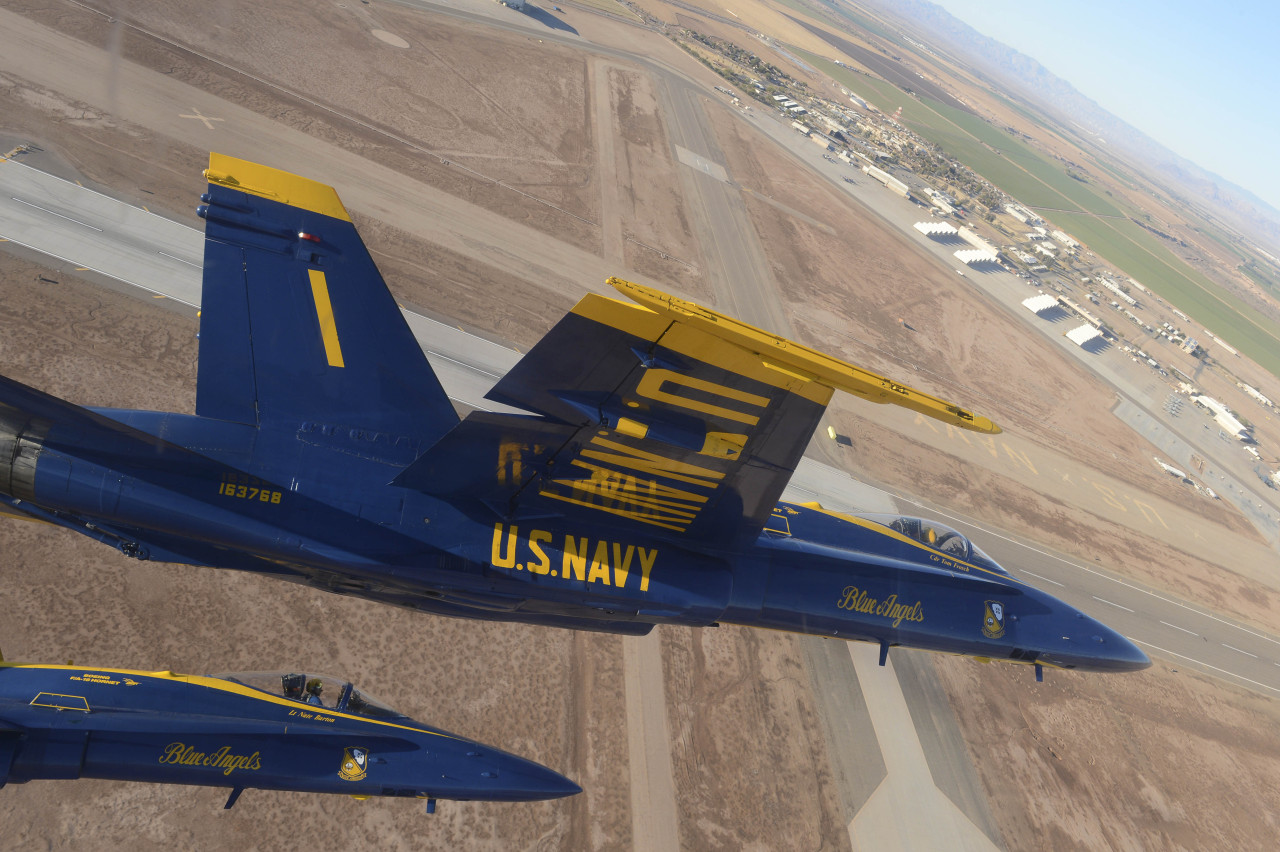 The Blue Angels fly in diamond formation.