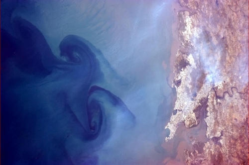 Huge swirls in the sea off of Mumbai, India.