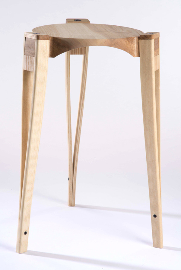 livingwellwhiledoinggood:  Crutch Stool by Alex Chow & Matt Muller. The seat is CNC machined to house the legs, making assembly quick and intuitive.