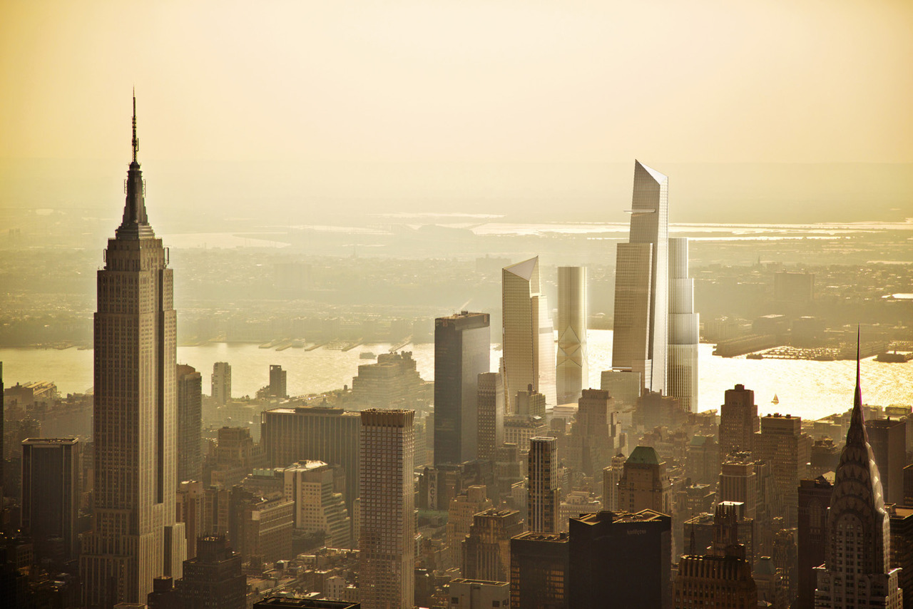 "modernizing:  New York City is about to undergo one of the most interesting construction projects of recent history, building what is essentially an entire neighbourhood from scratch. Overseen by real estate firm Related Companies, the project will see sixteen skyscrapers constructed on Manhattan's West Side Yard, adding over 12 million square feet of office, residential, and retail space to the area.  ""After years and years of planning and partnership, breaking ground on the first commercial building of Hudson Yards is a wonderful thing. Today's groundbreaking means that the market has spoken, and that even in this challenging economy we're moving forward to make the Far West Side's economic potential a reality."" said Mayor Michael Bloomberg."