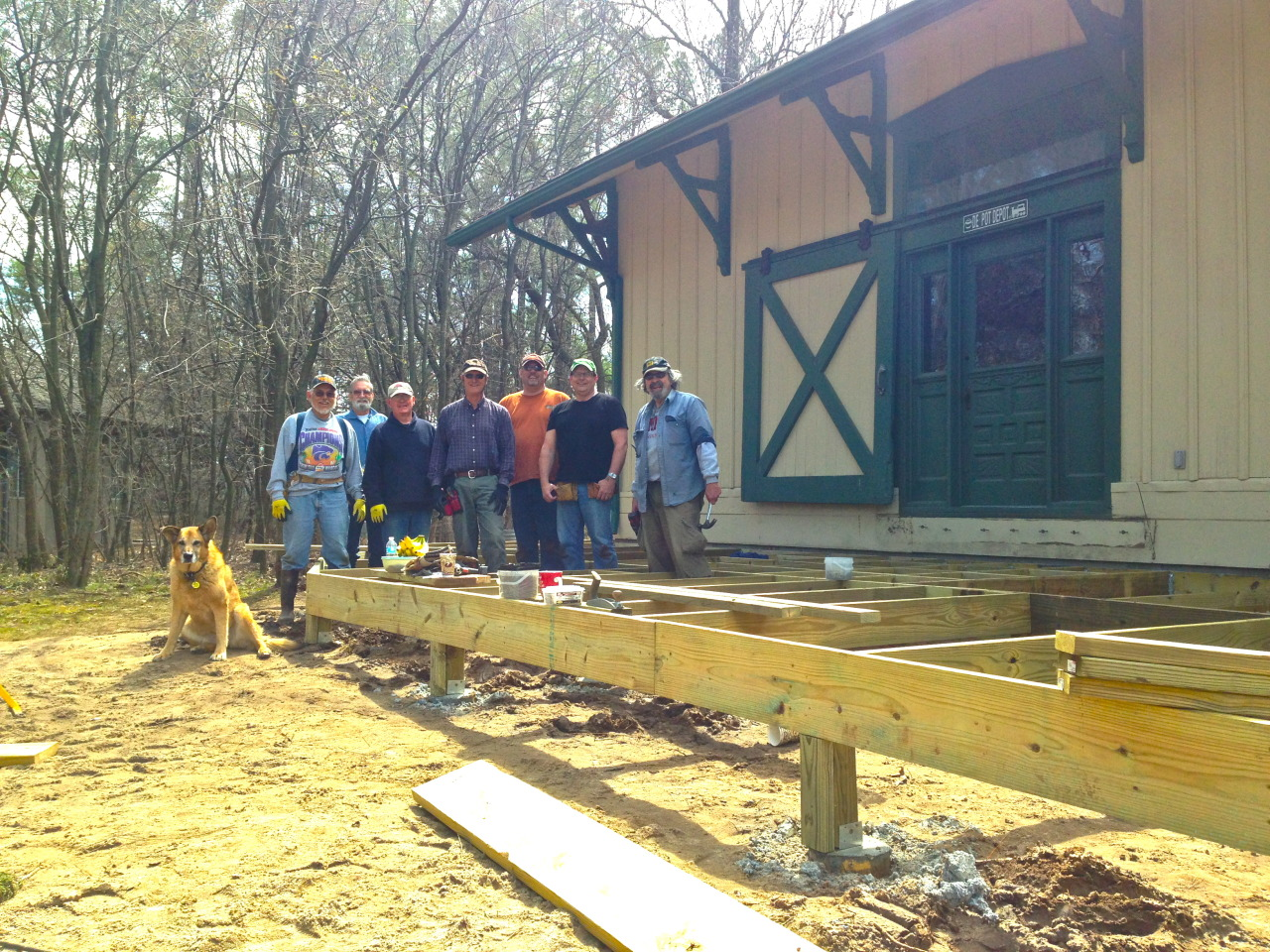 Bartlett Boardwalk Boys, led by the Venerable VanderWall, are building decking to enhance the depot, just in time for Tulip Time.